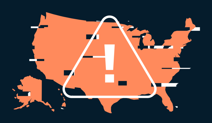 A glitched orange map of the US. Overlaid on top is a white triangle with an exclamation point in the center.